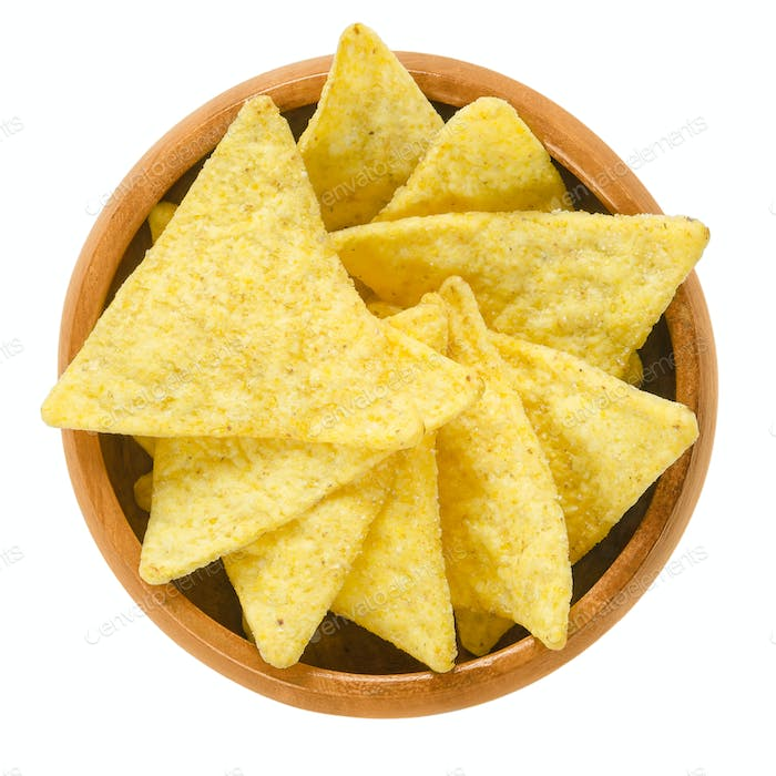 Tortilla chips in wooden bowl over white