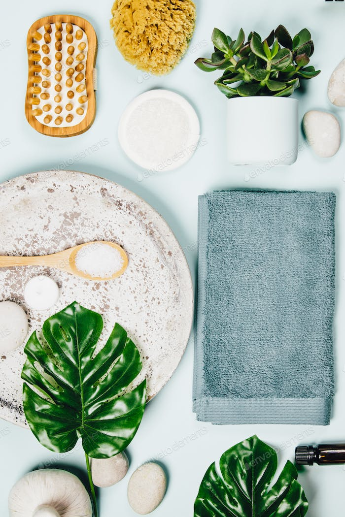 monstera leaves and cosmetic care products