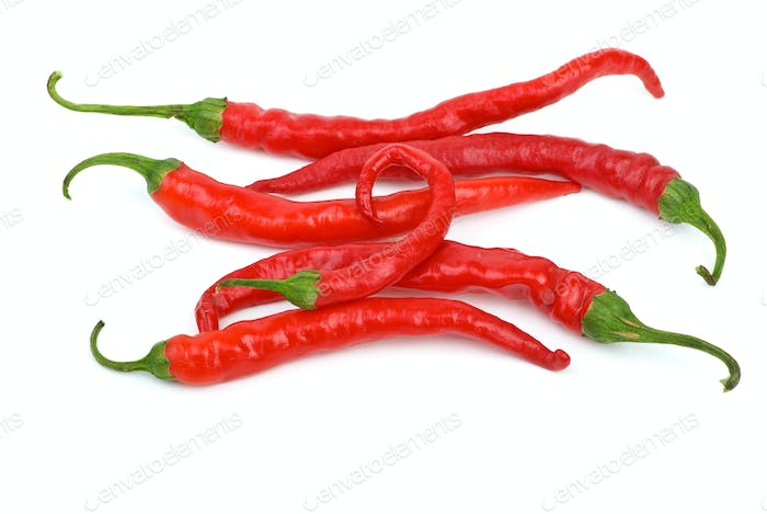 Some long curved red chili peppers