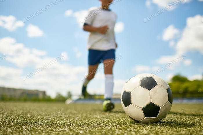 Young Boy Playing Sports