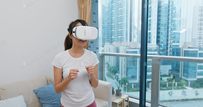 Woman play boxing with VR