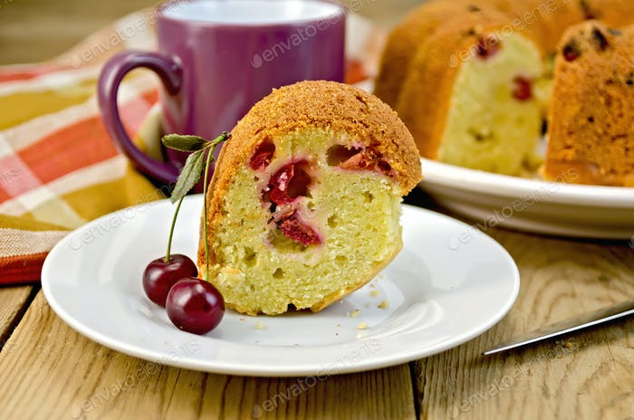 Cake with cherries and plate on board