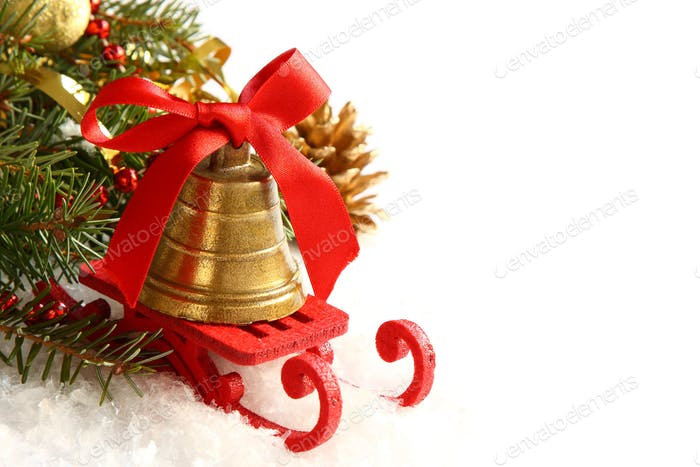Christmas composition with sleigh and golden bell over white