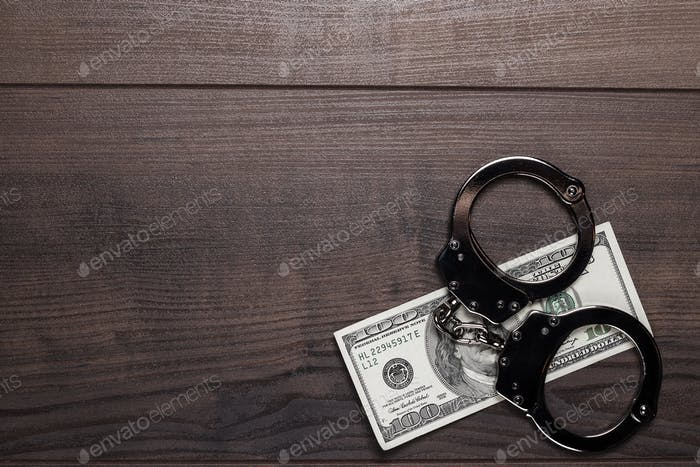 Handcuffs And One Hundred Dollars Background