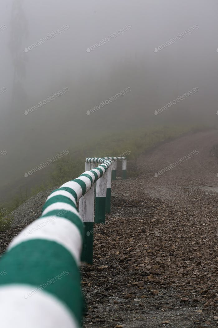 one balustrade in foggy scenery