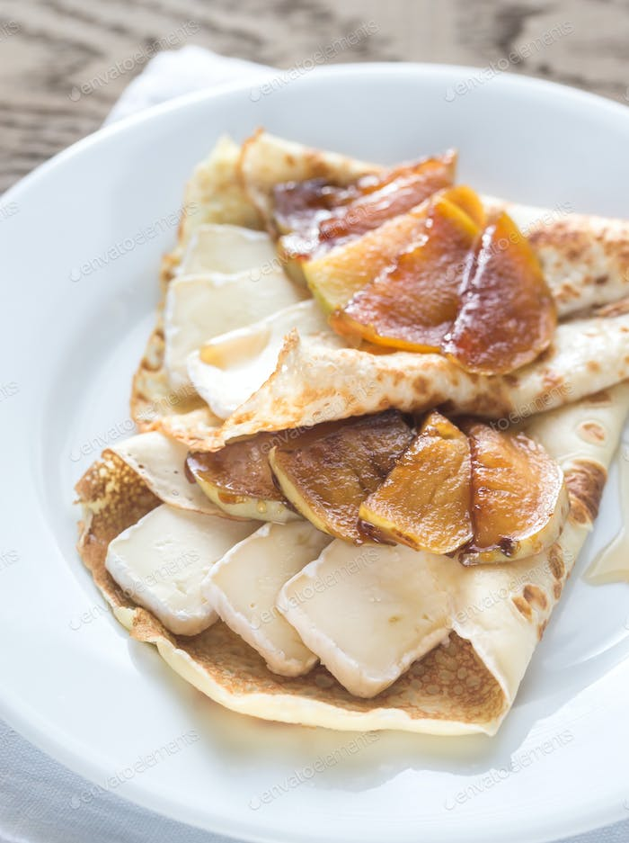 Crepes with brie and caramelized slices of apple