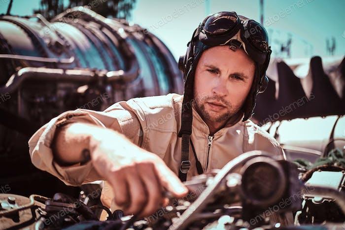 Pensive pilot is fixing jet's engine