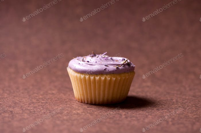 Vanilla muffin with raspberry cream topping and sweet flavours