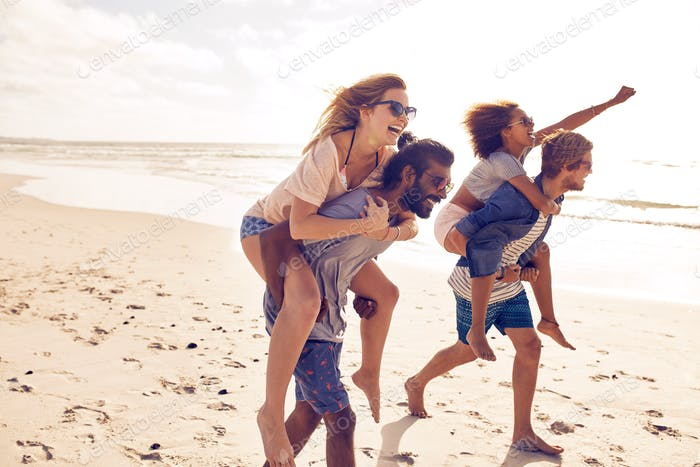Young friends enjoying summertime on the beach