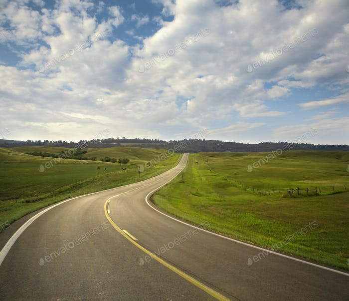 Curving Highway and Clouds in the Black Hills of South Dakota