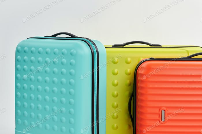 Cropped image of bright luggages