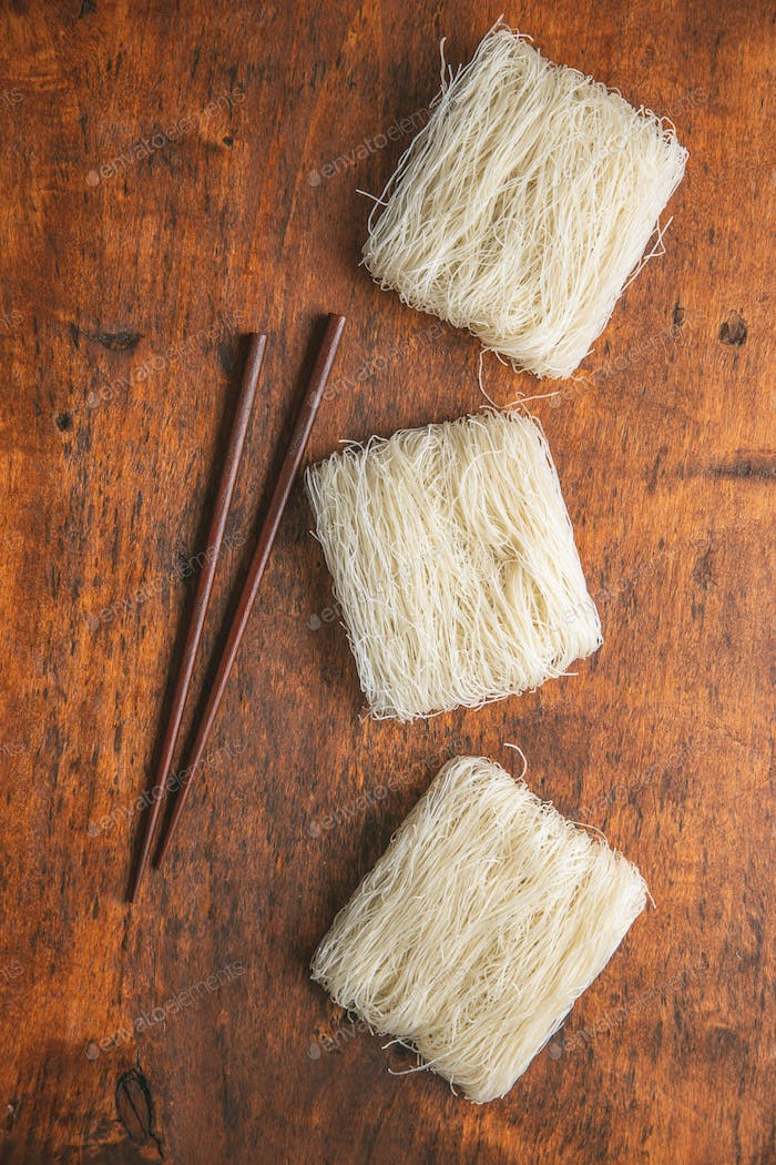Uncooked white rice noodles.