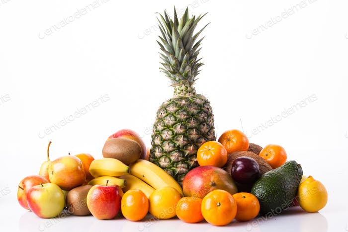 Fresh fruits.  Assortment of exotic fruits isolated on white