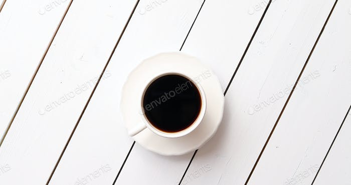 Cup of hot beverage on table