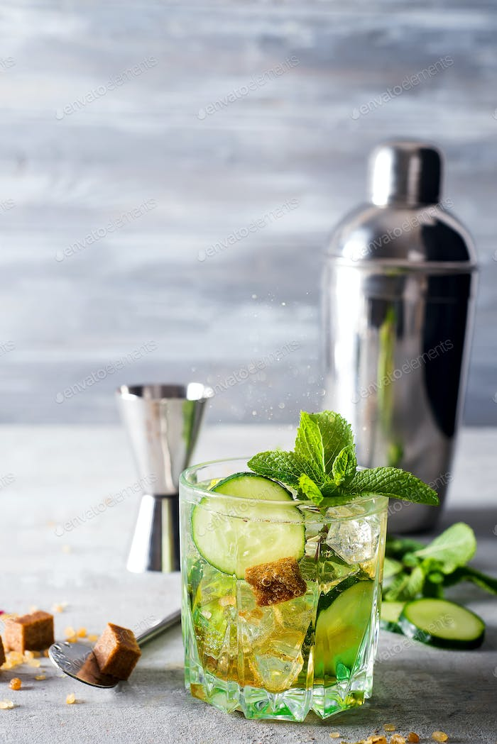 Nutritious detox water with lime and cucumber in a glass against