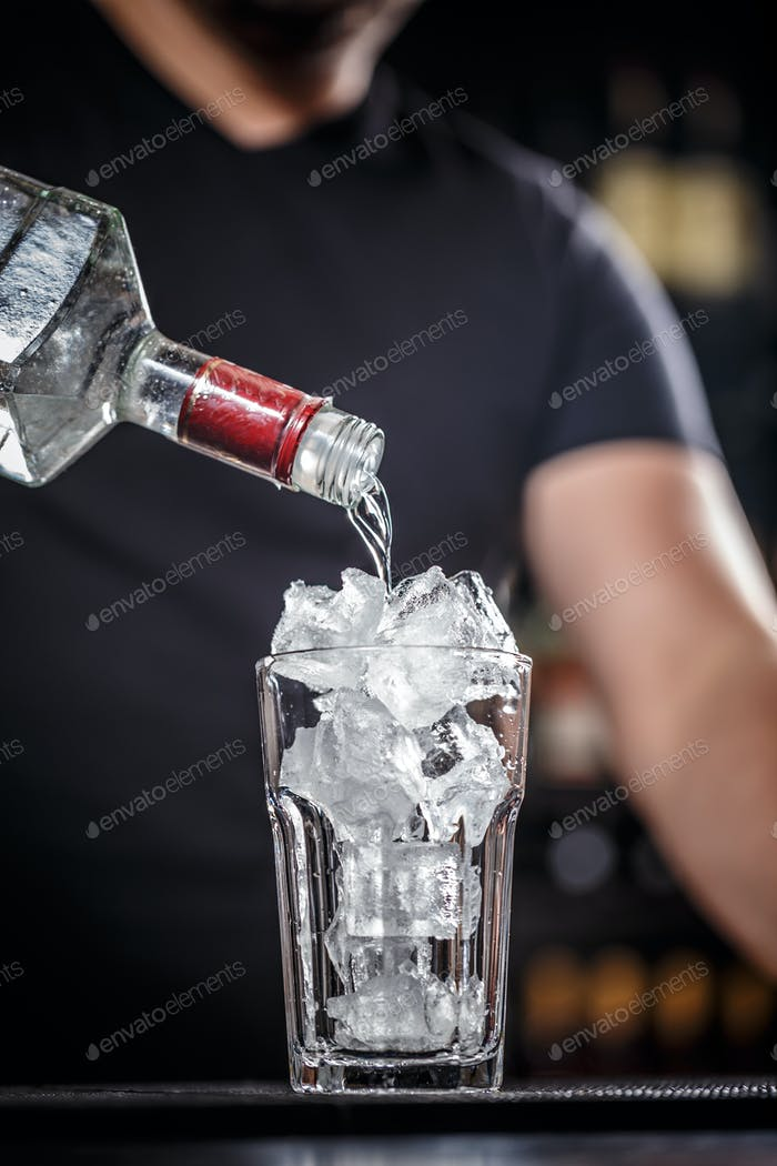 Bartender is preparing cocktail