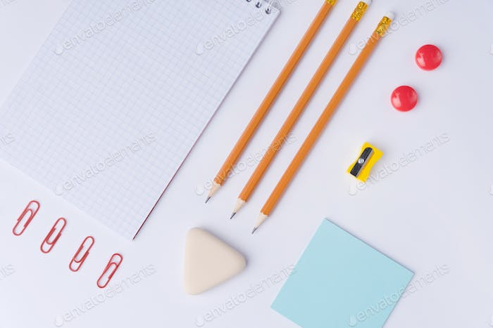 Office supplies on the white background table