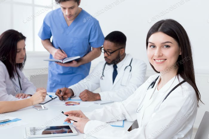 Team of doctors having meeting in medical office