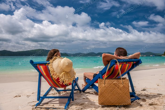 Thumbnail for Couple on tropical beach in loungers