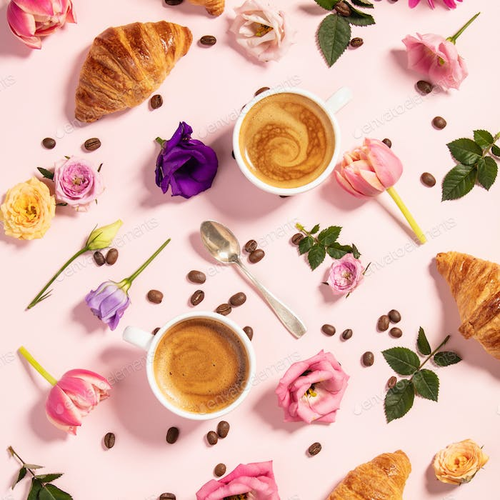 Morning coffee, croissants and a beautiful flowers . Flat lay style.