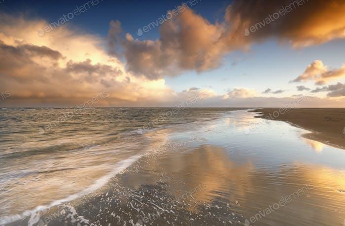 beautiful gold sunrise on North sea coast