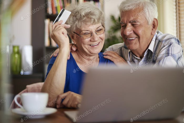 Senior couple browsing Internet without any problems