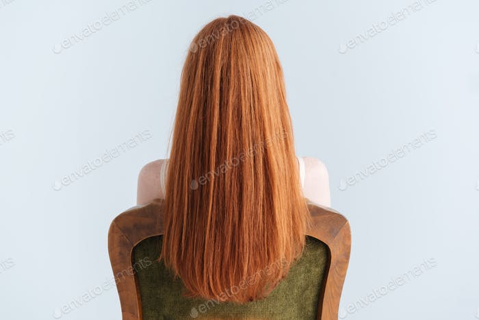 Redhead woman sitting on the chair