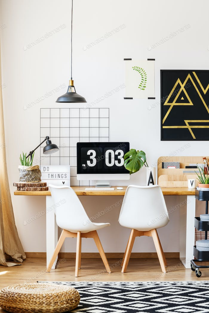 Designer chairs and wooden desk