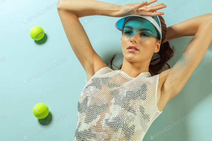 fashion model with tennis balls