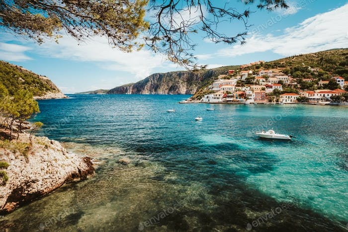 Greece summer vacation. Beautiful Assos small town located on Kefalonia island. Bay with boats and