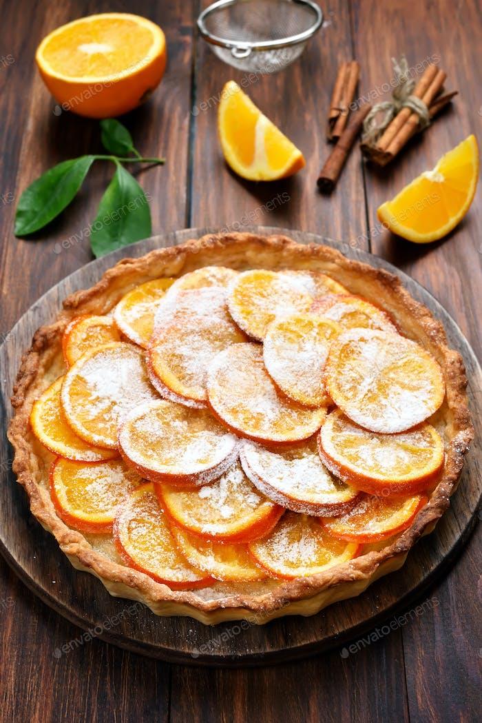 Pie with orange caramelized slices