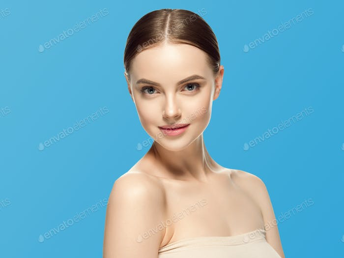 Woman face beauty healthy skin natural makeup beautiful female blue background