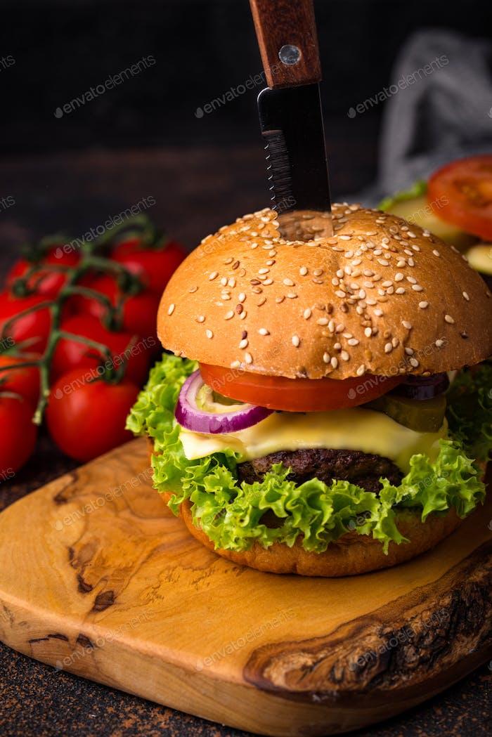 Burger and cheeseburger with tomato
