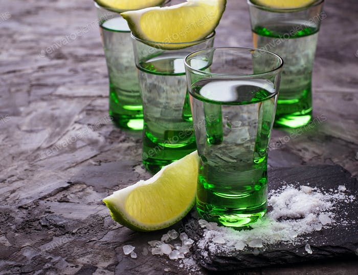 Shots of silver tequila with lime and salt