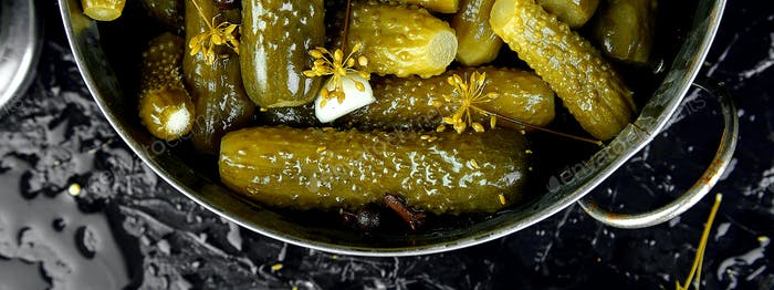 Banner of Canned cucumbers in a metal pan.