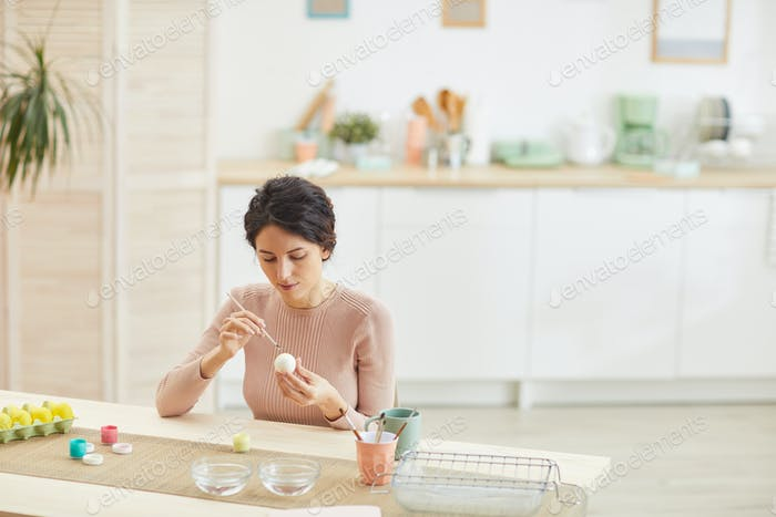 Young Woman Painting Easter Eggs