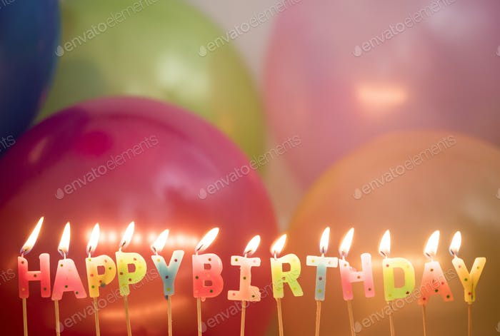 closeup of lit birthday candles birthday wishes concept photo by