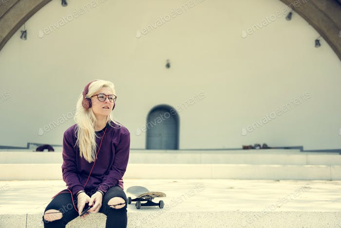 Woman Sitting Listening Music Headphone Concept