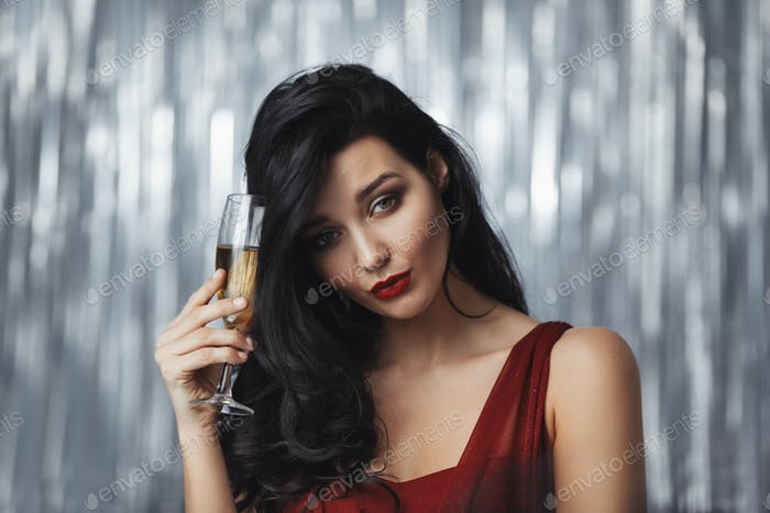 Drunk celebrating woman in red dress