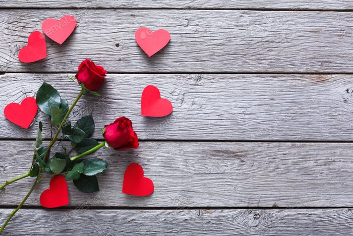 Valentine day background, hearts and rose flowers on wood