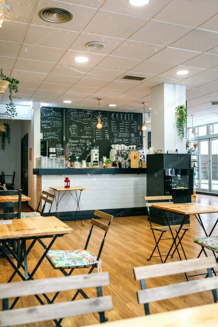 Empty cafe interior with chairs and tables