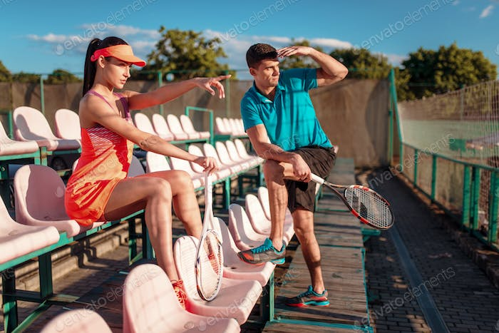 Woman and her trainer on tennis competition