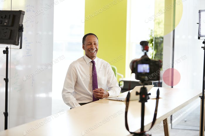 Middle aged businessman making a corporate video
