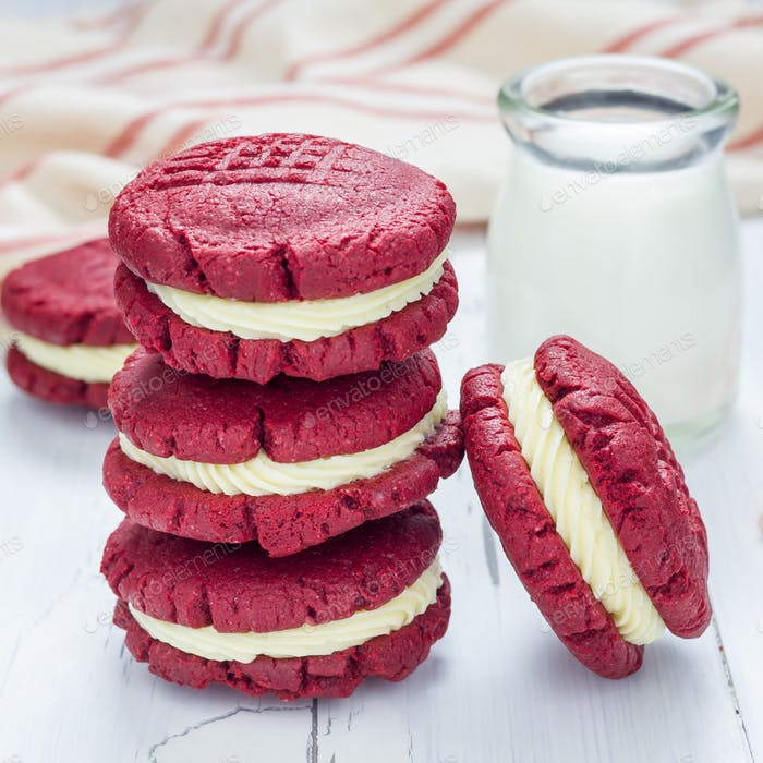 Red velvet sandwich cookies with cream cheese filling, square