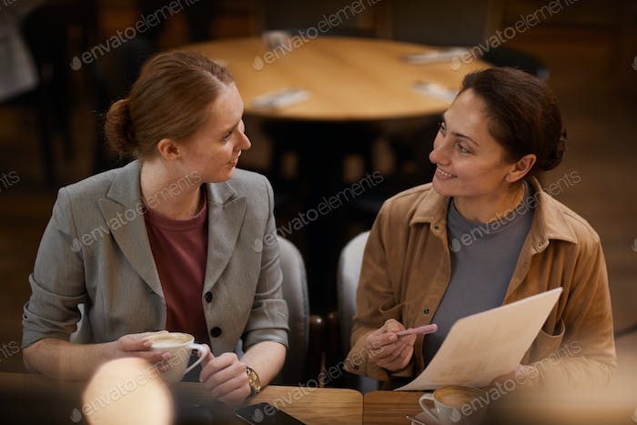 Businesswomen discussing contract