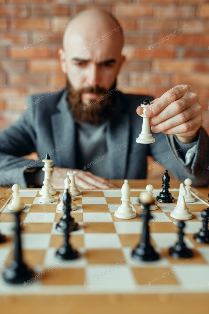 Chess player playing white figures, queen move
