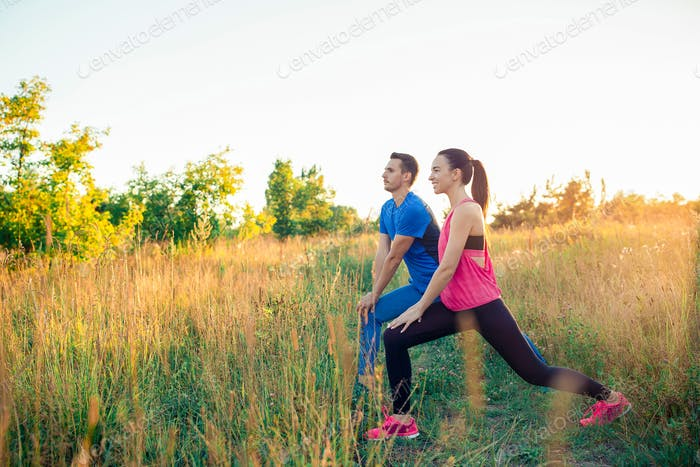 Active sportive couple running in park. Health and fitness
