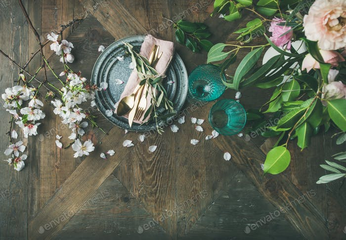 Flat-lay of Table setting with almond blossom flowers and peonies