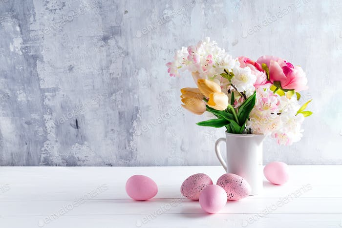 Easter greeting card backdrop with colorful spring flowers on white background. With copy space