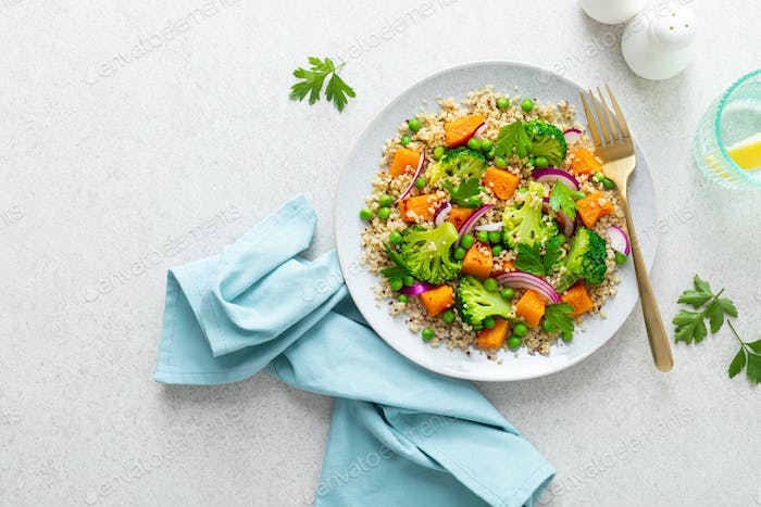 Vegetarian quinoa and broccoli warm salad with baked butternut squash